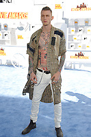 Machine Gun Kelly at the 2015 MTV Movie Awards at the Nokia Theatre LA Live.<br /> April 12, 2015  Los Angeles, CA<br /> Picture: Paul Smith / Featureflash