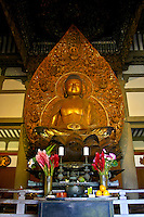Statue of the Buddha in the Byodo-in Temple located in the Valley of the Temples, Windward Oahu.