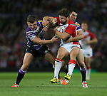 St Helens Tom Makinson is tackled- First Utility Super League Grand Final - St Helens v Wigan Warriors - Old Trafford Stadium - Manchester - England - 11th October 2014 - Pic Paul Currie/Sportimage