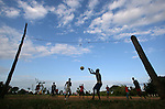 TANGA, TANZANIA - JULY 7:  Boys play football with makeshift goal posts made from free stumps at a school in a rural area outside of Tanga, Tanzania on July 7, 2010. Football is the most popular sport and pastime in Tanzania, and with the presence of the World Cup in South Africa the popularity of the sport has become contagious.