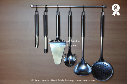Cooking utensils hanging from hooks in kitchen (Licence this image exclusively with Getty: http://www.gettyimages.com/detail/93187599 )