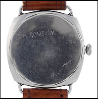 BNPS.co.uk (01202 558833)<br /> Pic: Fellows/BNPS<br /> <br /> Sgt Rowson scratched his own initials into the back of the watch.<br /> <br /> Resurfacing - Historic watch captured from a brave German frogman, for whom the road bridge at Nijmegen proved a bridge to far.<br /> <br /> The family of a British WW2 hero who captured a German diver trying to blow up a vital bridge in the wake of Operation Market Garden, are now <br /> selling the incredibly rare Rolex Panerai watch seized from the exhausted diver.<br /> <br /> Sergeant Major George Rowson helped thwart the attempt to destroy the recently captured road bridge at Nijmegen after another team of German frogman had managed to destroy the neighbouring rail bridge.<br /> <br /> The highly trained German special forces placed fixed charges to the underwater footings of both bridge's, but after being spotted, under heavy fire, and in an exhausted state they were captured at gunpoint by Sgt Rowson and his colleagues. <br /> <br /> Sgt Rowson relieved the frogman of his precious watch and wetsuit and kept them until his recent death.<br /> <br /> His family are now selling the historic artefacts with specialist Auctioneers Fellows in Birmingham, with a whopping &pound;40,000 estimate.