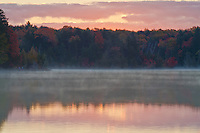 The sun rises over Pete's Lake in Schoolcraft County in the Hiawatha National Forest in Michigan's Upper Peninsula