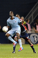 CJ Sapong (17) Sporting KC forwrad controls the ball in the air in front of Shalrie Joseph New England... Sporting Kansas City defeated New England Revolution 3-0 at LIVESTRONG Sporting Park, Kansas City, Kansas.
