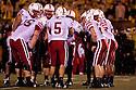 08 October 2009: Nebraska huddle in the rain against Missouri at Memorial Stadium, Columbia, Missouri. Nebraska defeated Missouri 27 to 12.