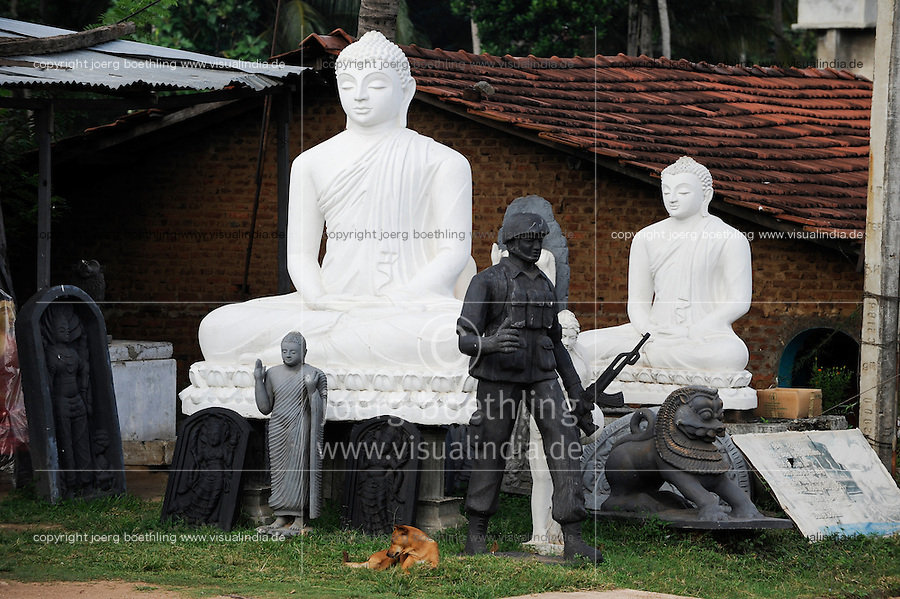 SRI LANKA, new buddhist stupa construction is going on after war against  the LTTE tamil tigers, buddha and singhalese soldier sculptures in sculpture workshop / SRI LANKA, nach dem Sieg gegen die LTTE Tamil Tiger werden in tamilischen Gebieten auffaellig viele neue buddhistische Stupa gebaut, Werkstatt eines Skulpteurs, Buddha Figuren und Skulptur eines singhalesischen Soldaten