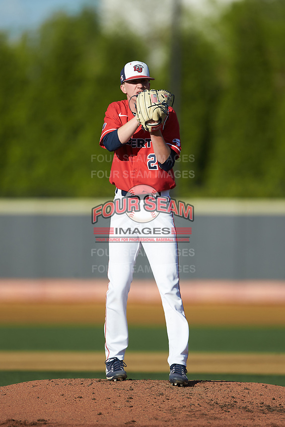 Liberty Flames starting pitcher Mason Hand (25) looks to his catcher for the sign against the Wake Forest Demon Deacons at David F. Couch Ballpark on April 25, 2018 in  Winston-Salem, North Carolina.  The Demon Deacons defeated the Flames 8-7.  (Brian Westerholt/Four Seam Images)