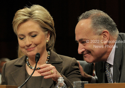 Washington, DC - January 13, 2009 -- United States Senator Chuck Schumer (Democrat of New York), right, introduces his colleague, United States Senator Hillary Rodham Clinton (Democrat of New York), left, as the United States Senate Foreign Relations Committee conducts a confirmation hearing for her as United States Secretary of State in Washington, D.C. on Tuesday, January 13, 2009..Credit: Ron Sachs / CNP.(RESTRICTION: NO New York or New Jersey Newspapers or newspapers within a 75 mile radius of New York City)
