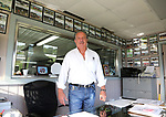 Owner Ernie Denofa  in the office amongst the many win photos at Westampton Farm and Training Center in Westampton, New Jersey