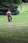 A Native American Lakota Sioux Indian woman walking outside with a blanket