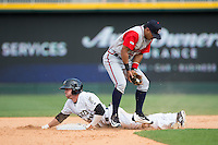 Emerson Landoni (27) of the Gwinnett Braves blocks a low throw as J.B. Shuck (30) of the Charlotte Knights slides head first into second base at BB&T BallPark on May 22, 2016 in Charlotte, North Carolina.  The Knights defeated the Braves 9-8 in 11 innings.  (Brian Westerholt/Four Seam Images)