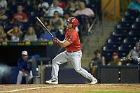 Scott Schebler (15) of the Louisville Bats follows through on his swing against the Durham Bulls at Durham Bulls Athletic Park on May 28, 2019 in Durham, North Carolina. The Bulls defeated the Bats 18-3. (Brian Westerholt/Four Seam Images)