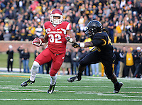 NWA Media/Michael Woods --11/28/2014-- w @NWAMICHAELW...University of Arkansas running back Jonathan Williams tries to shake Missouri defender Clarence Green as he runs for a gain in the 2nd quarter of Friday afternoons game against Missouri at Faurot Field in Columbia Missouri.