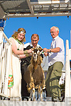Queen of Puck places the Crown on King Puck at the Coronation in Killorglin on Monday helped by goat catchers Frank Joy Killorglin and Seamus Blaney Ballycastle, Co. Antrim