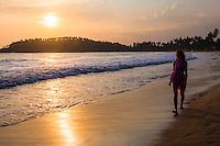 Mirissa, woman on holiday on Mirissa Beach at sunset, South Coast of Sri Lanka, Southern Province, Asia. This is a photo of a woman on holiday on Mirissa Beach at sunset, Sri Lanka, Asia.