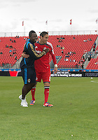 15 September 2012: Philadelphia Union midfielder/forward Freddy Adu #11 and Toronto FC midfielder Eric Avila #8 embrace after the warm-up in an MLS game between the Philadelphia Union and Toronto FC at BMO Field in Toronto, Ontario..The game ended in a 1-1 draw..