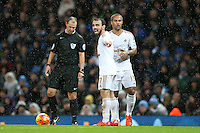 Leon Britton and Wayne Routledge arrange a two man defensive wall during the Barclays Premier League Match between Manchester City and Swansea City played at the Etihad Stadium, Manchester on 12th December 2015