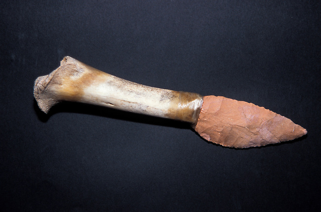 Wichita stone knife blades were flinted with a sharp edge and wrapped onto a bone or antler handle with sinew to easily handle butchering and cutting through raw meat after a successful hunt