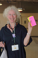 OrigamiUSA 2016 Convention at St. John's University, Queens, New York, USA. Ben Fritzson updates sold out classes. Ruth Tepper, shows her class tickets.