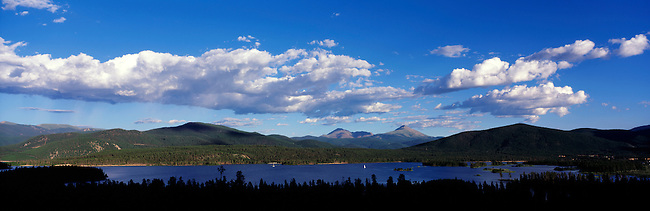 A lone sailboat on Dillon Reservoir can be seen from Arapaho National Forest, near Frisco, Colorado.