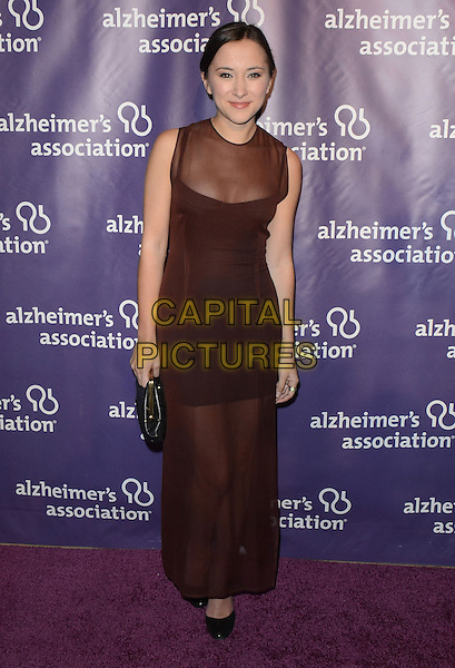 "Zelda Williams.21st Annual Alzheimer's Association ?A Night at Sardi's"" held at the Beverly Hilton Hotel, Beverly Hills, California, USA, 20th March 2013..full length brown sheer dress long maxi see thru through  black clutch bag purse shoes .CAP/ADM/KB.©Kevan Brooks/AdMedia/Capital Pictures."