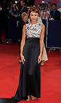 Olga Kurylenko pose on the red carpet as they arrives for the screening of 'The November Man' during the 40th Deauville American Film Festival on September 5, 2014 in Deauville,