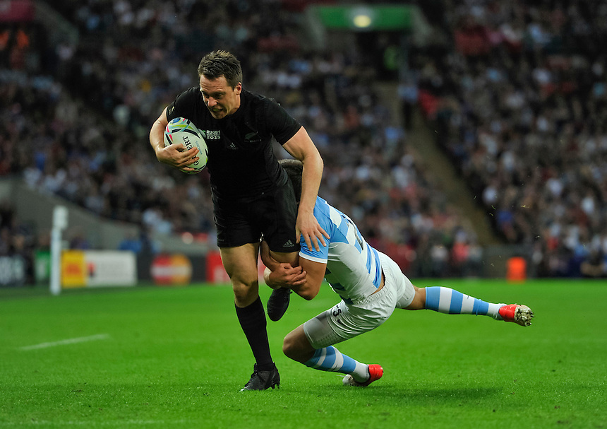 New Zealand's Ben Smith is tackled just short of the line<br /> <br /> Photographer Ashley Western/CameraSport<br /> <br /> Rugby Union - 2015 Rugby World Cup - New Zealand v Argentina - Sunday 20th September 2015 - Wembley Stadium - London <br /> <br /> &copy; CameraSport - 43 Linden Ave. Countesthorpe. Leicester. England. LE8 5PG - Tel: +44 (0) 116 277 4147 - admin@camerasport.com - www.camerasport.com