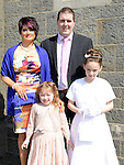 Ella Duff Finnegan who received first holy communion in the church of Mary Immaculate in Collon pictured with parents Alan and Lisa and sister Kira. Photo:Colin Bell/pressphotos.ie