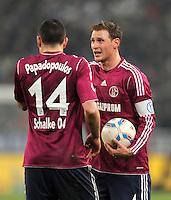 Fussball DFB Pokal:  Saison   2011/2012  Achtelfinale  21.12.2011 Borussia Moenchengladbach - FC Schalke 04 Kyriakos Papadopoulos, Benedikt Hoewedes (v. li., FC Schalke 04)