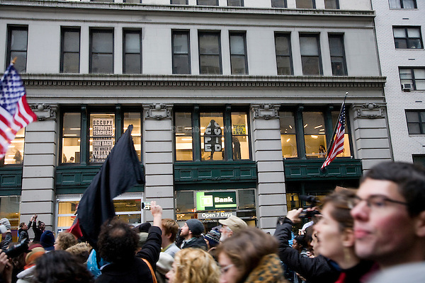 """Students, workers, and other supporters march from Union Square Park to demonstrate continued solidarity with the Occupy Wall Street movement on its two month anniversary, which the movement has dubbed its """"Day of Action"""" in New York City, New York on 17 November 2011."""