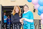 The first woman home in the 5k at the Top of Coom run on Sunday last was Bernie O'Mahony from Farranfore Maine Valley being presented with her prize from organiser, Abby O'Leary.