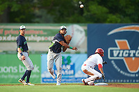 Vermont Lake Monsters second baseman Jesus Lopez (9) throws to first base as Blake Perkins (7) slides into second and shortstop Eli White (27) backs up the play during a game against the Auburn Doubledays on July 12, 2016 at Falcon Park in Auburn, New York.  Auburn defeated Vermont 3-1.  (Mike Janes/Four Seam Images)