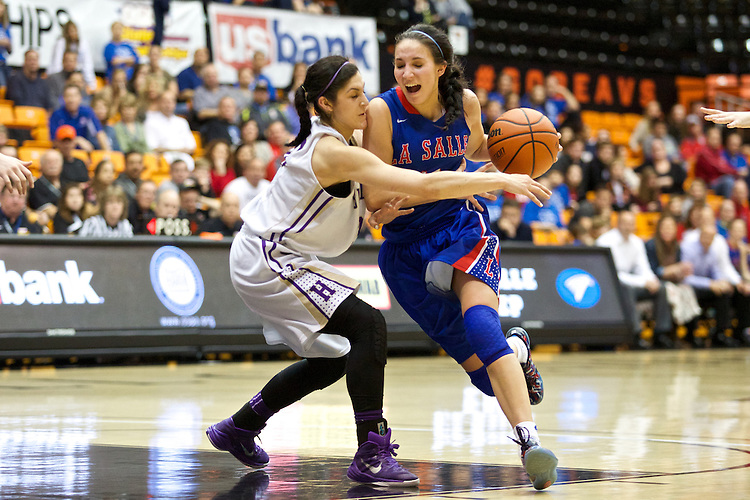 Mar 11, 2015; Portland, OR, USA;  La Salle Prep guard Aleah Goodman drives to the basket against Hermiston Bulldogs guard Sara Ramirez in the 5A Girls Basketball State Championship at Gill Coliseum.<br /> Photo by Jaime Valdez