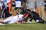 Wendell Dunn (14) of the Wake Forest Demon Deacons falls on Ryan Finley (15) of the North Carolina State Wolfpack after Finley recovered a fumble during second half action at BB&T Field on November 18, 2017 in Winston-Salem, North Carolina.  The Demon Deacons defeated the Wolfpack 30-24.  (Brian Westerholt/Sports On Film)
