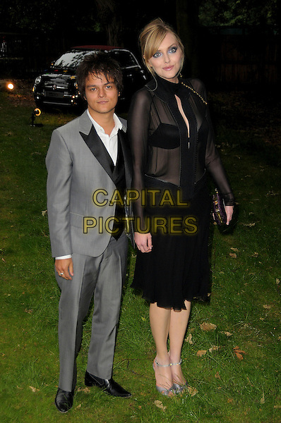 JAMIE CULLUM & SOPHIE DAHL.Raisa Gorbachev Foundation Gala Dinner at Stud House, Hampton Court, London, England..June 6th, 2009.full length jaime grey gray suit black dress silver open toe shoes sheer long sleeves sleeved bra see through ankle strap couple tall short .CAP/CAS.©Bob Cass/Capital Pictures.
