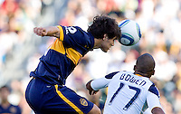 Boca Juniors defender Ezequiel Munoz (6) beats LA Galaxy forward Tristan Bowen (17) fto the ball. The LA Galaxy defeated Boca Juniors 1-0 at Home Depot Center stadium in Carson, California on Sunday May 23, 2010.  .