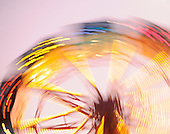 Stock photo of spinning wheel with lights and color