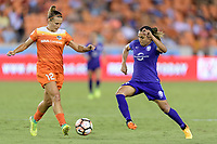 Houston, TX - Saturday June 17, 2017: Marta Vieira Da Silva attempts to steal the ball from Amber Brooks during a regular season National Women's Soccer League (NWSL) match between the Houston Dash and the Orlando Pride at BBVA Compass Stadium.