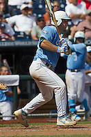 North Carolina catcher Brian Holberton (10) follows through on his swing during Game 3 of the 2013 Men's College World Series against the North Carolina State Wolfpack at TD Ameritrade Park on June 16, 2013 in Omaha, Nebraska. The Wolfpack defeated the Tar Heels 8-1. (Andrew Woolley/Four Seam Images)