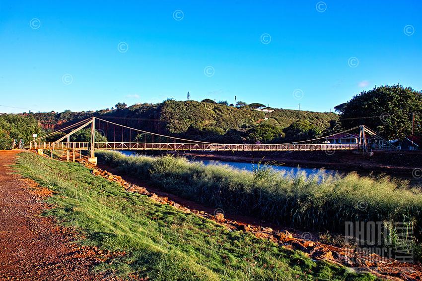 This swinging suspension bridge over the Hanapepe River is a landmark tourist attraction in quaint Hanapepe, Kaua'i.