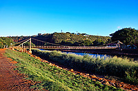 This swinging suspension bridge over the Hanapepe River is a landmark tourist attraction in quaint Hanapepe, Kaua'i.
