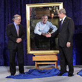 Washington, DC - December 19, 2008 -- United States President George W. Bush, right looks to shake hands with himself in the painting with artist Robert Anderson after the unveiling of his portrait at the National Portrait Gallery in Washington, D.C. on Friday, December 19, 2008. .Credit: Ken Cedeno / Pool via CNP