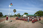 Students stand at attention as flags are raised at the beginning of the school day at the Loreto Primary School outside Rumbek, South Sudan. The school is run by the Institute for the Blessed Virgin Mary--the Loreto Sisters--of Ireland.