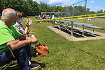 TORRINGTON, CT - 04 JULY 2020 - 070420JW05.jpg --  Dick and Carol Sterpka cheer on Torrington Little League Brewers #12 Nathan Cravanzola from behind the caution tape during opening day of play at Torrington Middle school's Colangelo Fields Saturday afternoon. Jonathan Wilcox Republican-American