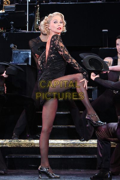 Christie Brinkley takes over the role of 'Roxie Hart' in 'Chicago' at the Cambridge Theatre, London, England..July 13th 2011.stage show performance acting full length black lace mini dress side leg foot up posing  .CAP/ROS.©Steve Ross/Capital Pictures