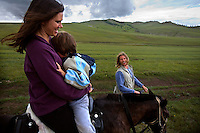 "Kristin Neff, a developmental psychologist, sits with her five-year-old autistic son, Rowan, on a horse during a horseback expedition across Mongolia. Rowan, who has been nicknamed ""The Horse Boy"", embarked on a therapeutic journey of discovery with his parents to visit a succession of shaman healers in one of the most remote regions in the world. Following Rowan's positive response to a neighbour's horse, Betsy, and some reaction to treatment by healers, Rowan's parents hoped that the Mongolian shamanistic rituals along the route and the prolonged contact with horses would help to unlock their son's autism and assist his development.."