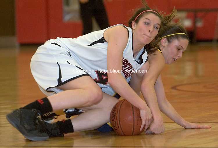 SOUTHBURY, CT. 08 March 2012-030812SV19-#4 Allison Wallace of Pomperaug High battles for the loose ball with #11 Marissa Larned of RHAM during the CIAC Class L quarterfinal in Southbury Thursday..Steven Valenti Republican-American