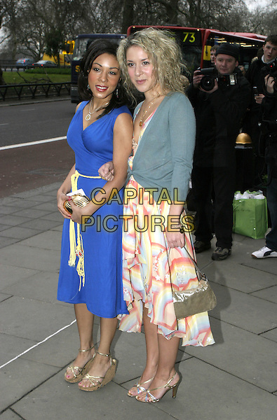 KATHRYN DRYSDALE & NATALIE CASEY.TRIC Awards - Television & Radio Industries Club at the Grosvenor House, Park Lane..March 8th, 2005.full length blue dress green cardigan arms linked gold purse bag.www.capitalpictures.com.sales@capitalpictures.com.© Capital Pictures.