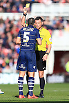 Referee Andre Marriner shows Giuseppe Bellusci of Leeds a yellow card - Middlesbrough vs. Leeds United - Skybet Championship - Riverside Stadium - Middlesbrough - 21/02/2015 Pic Philip Oldham/Sportimage