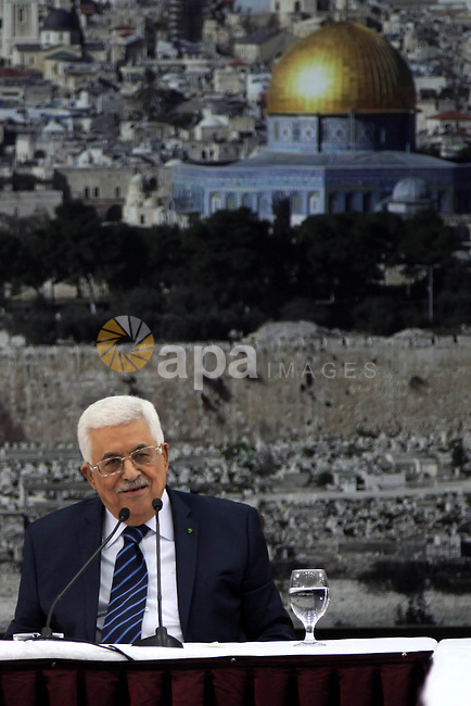 Palestinian President Mahmoud Abbas chairs a leadership meeting in the West Bank city of Ramallah on December 14, 2014. Photo by Shadi Hatem